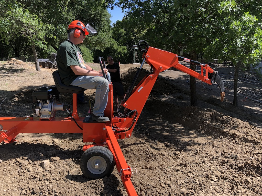 Richard tries out his digging machine