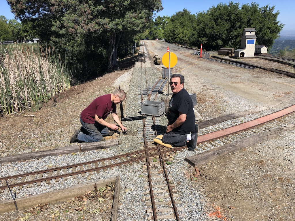 Tom & Carl install a switch stand for the North Yard -> Mountain Route  crossover
