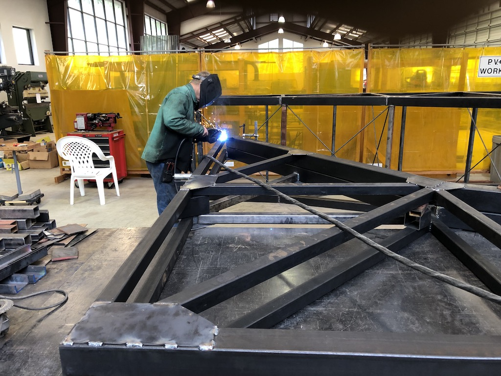 Tom welds on gussets