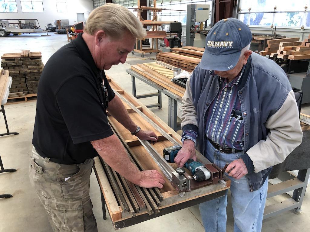 Kevin & Rene drill guard rail for bridge track panel