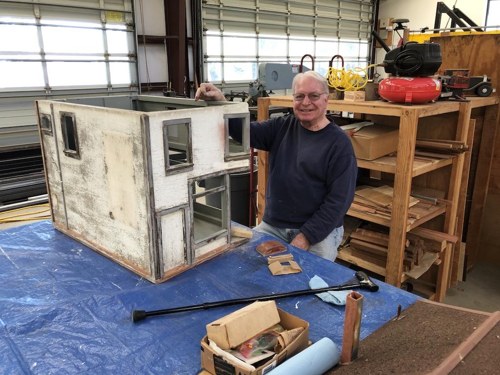 Ron workin on little buildings