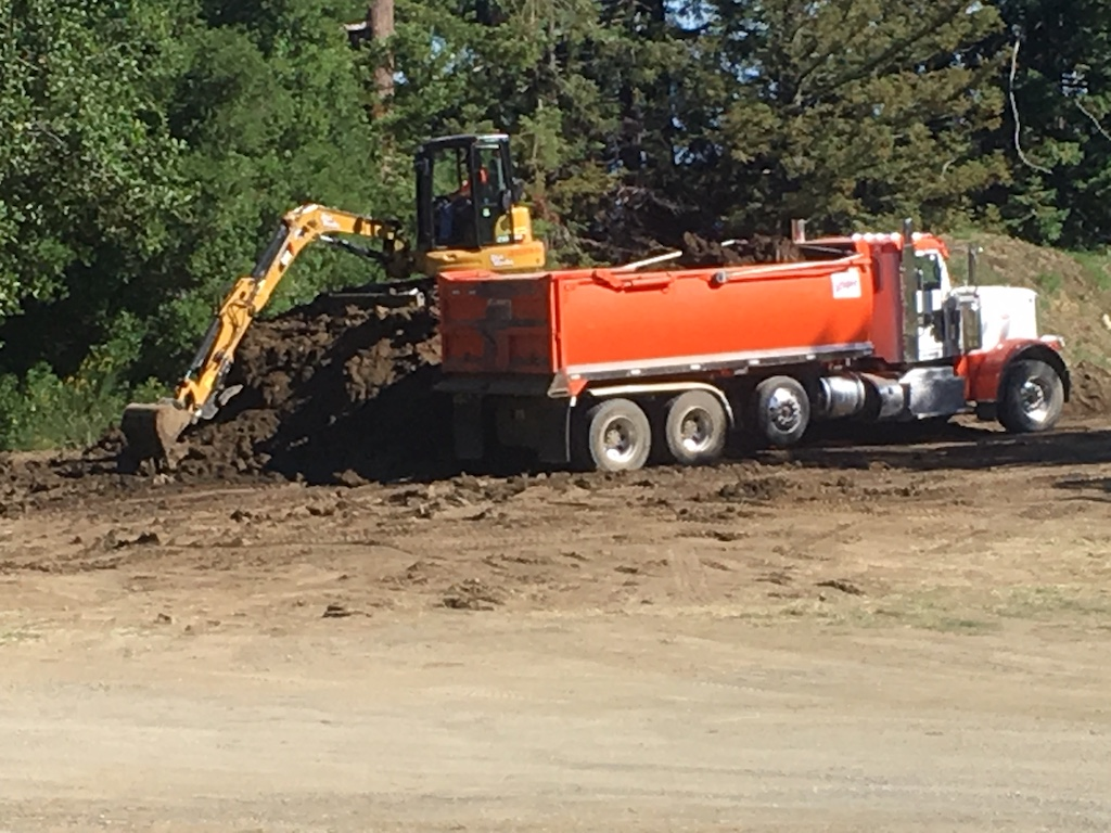 Removing dirt from the soccer field