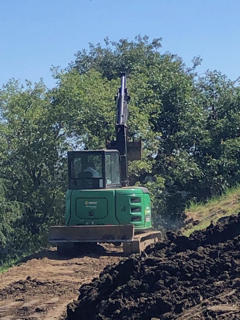 Bill running the excavator