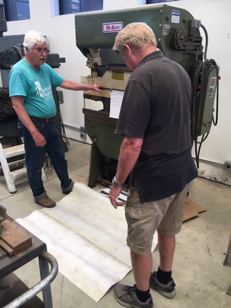 Randy and Kevin put a vinyl pad under the Di-Acro press brake to keep the cement floor oil-free.