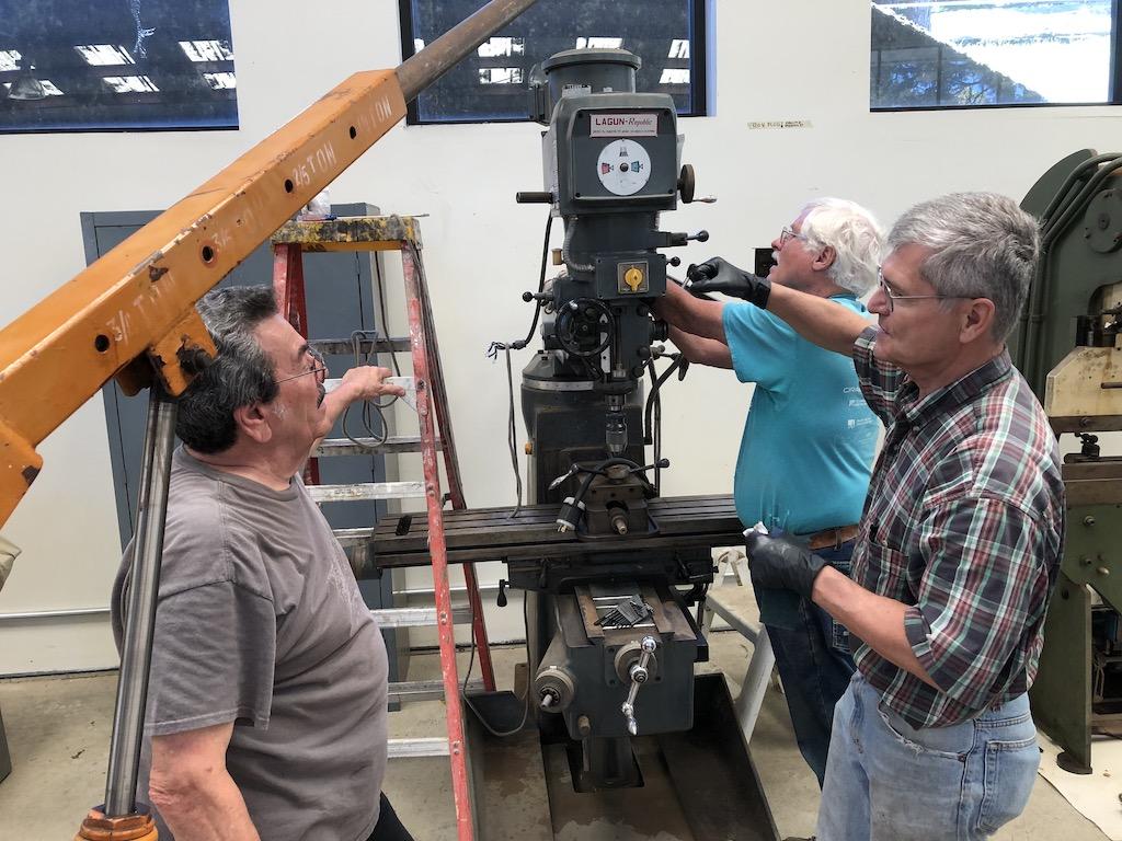 Carl, Randy, & Ken refurbish the mill