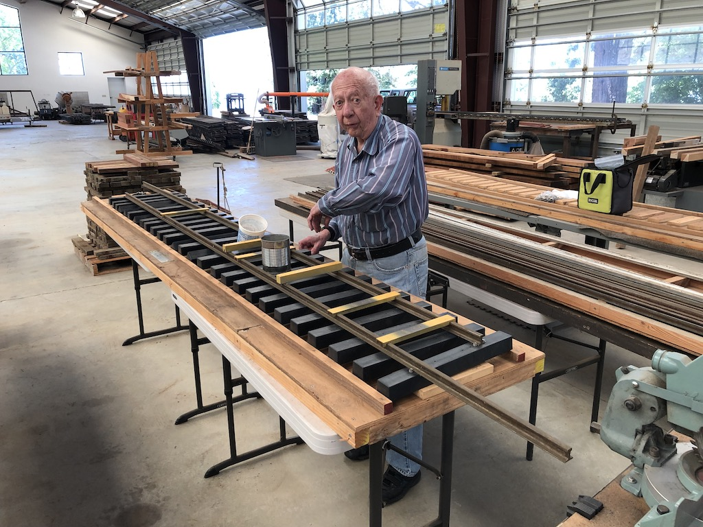 Rene works on track panels for the Lumber Camp Bridge