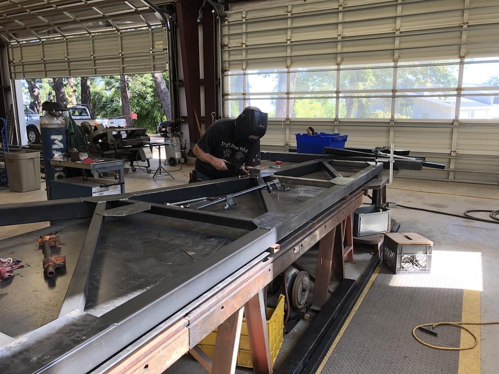 Tom continues welding the Lumber Camp Bridge