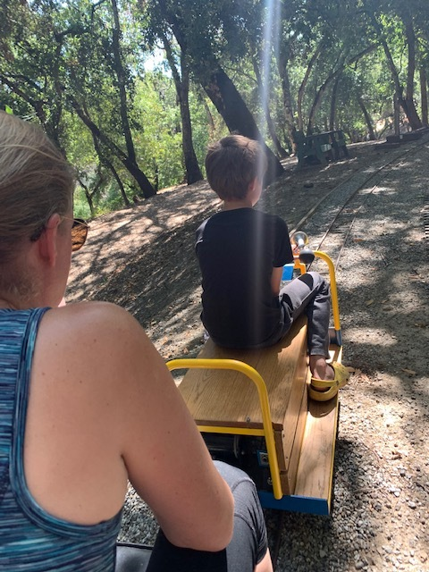 Miles tests out the Blum family's new speeder