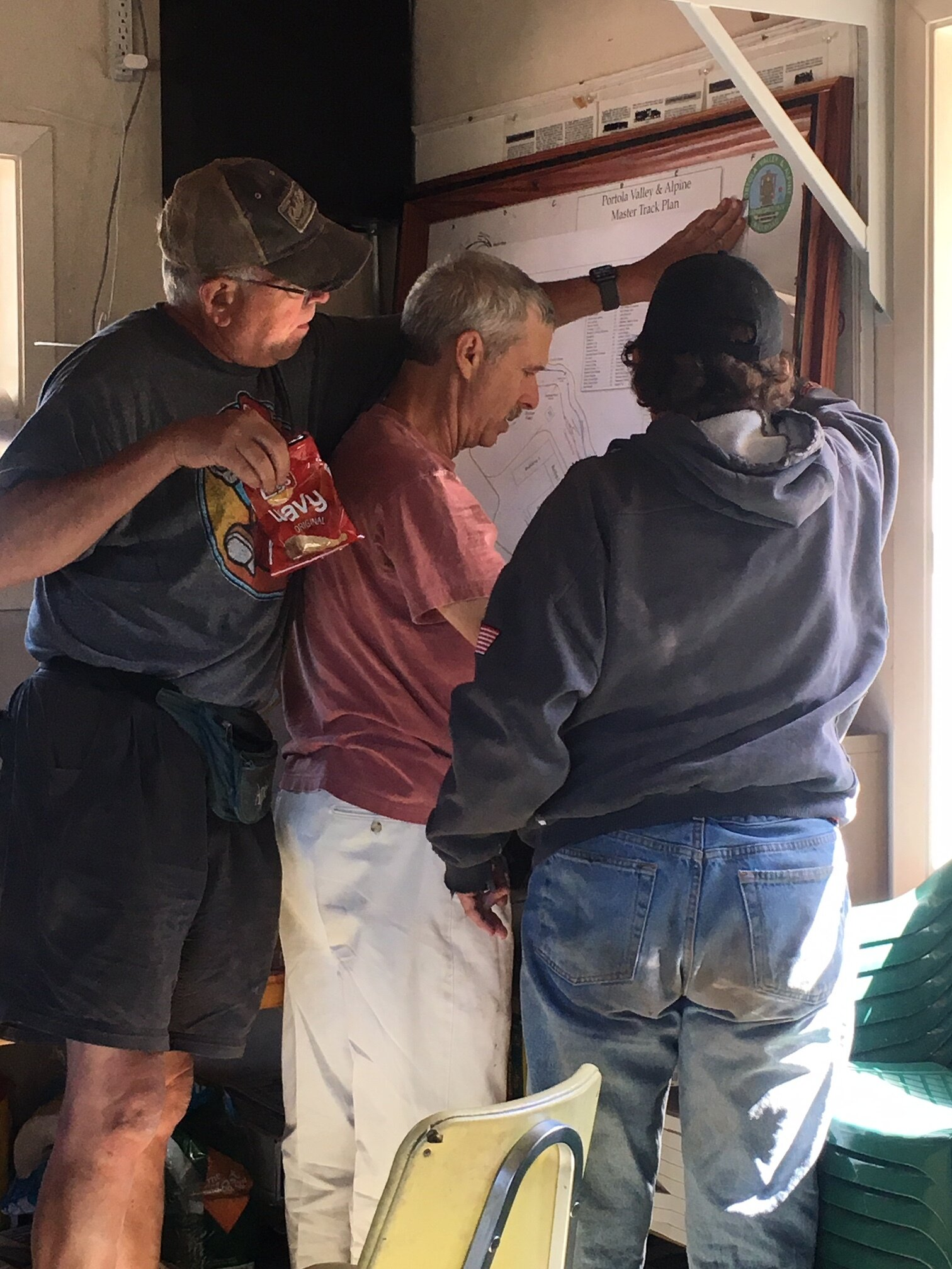 How many people does it take to hang an updated map?