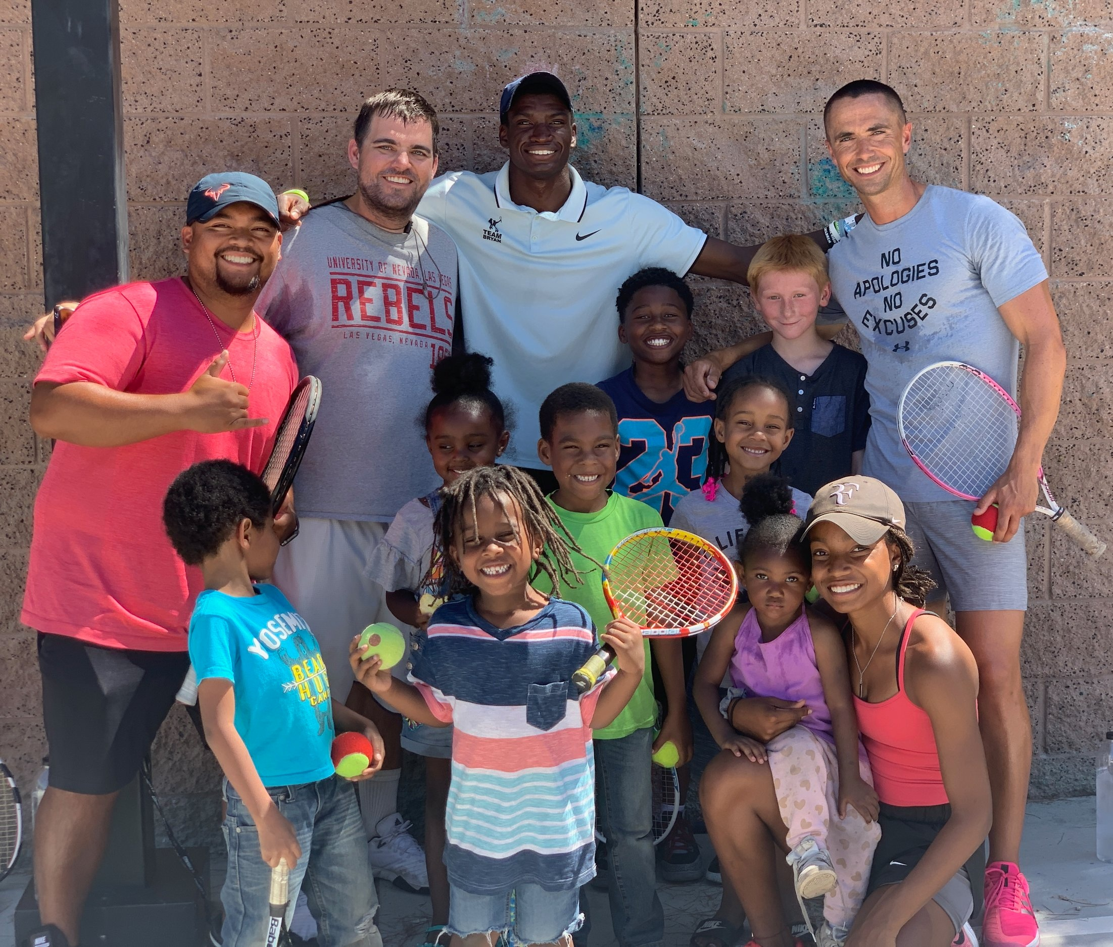 """Tennis On Wheels"" - USPTA Intermountain Division VP & U30 Lead Karl Jones and USPTA U30 Professionals Rudy Abitago, Jake Lysgaard, and Ricky Sypert with kids at The Shade Tree homeless shelter.Through their USPTA U30 ""Tennis On Wheels"" service, U30 professionals provided at-risk children at The Shade Tree, a safe shelter for homeless and/or abused women and children, with a tennis event at their facility."