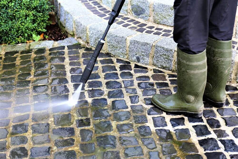 Jet washing to remove the algae and moss build up for a safer, cleaner surface. in Pontefract WF8.