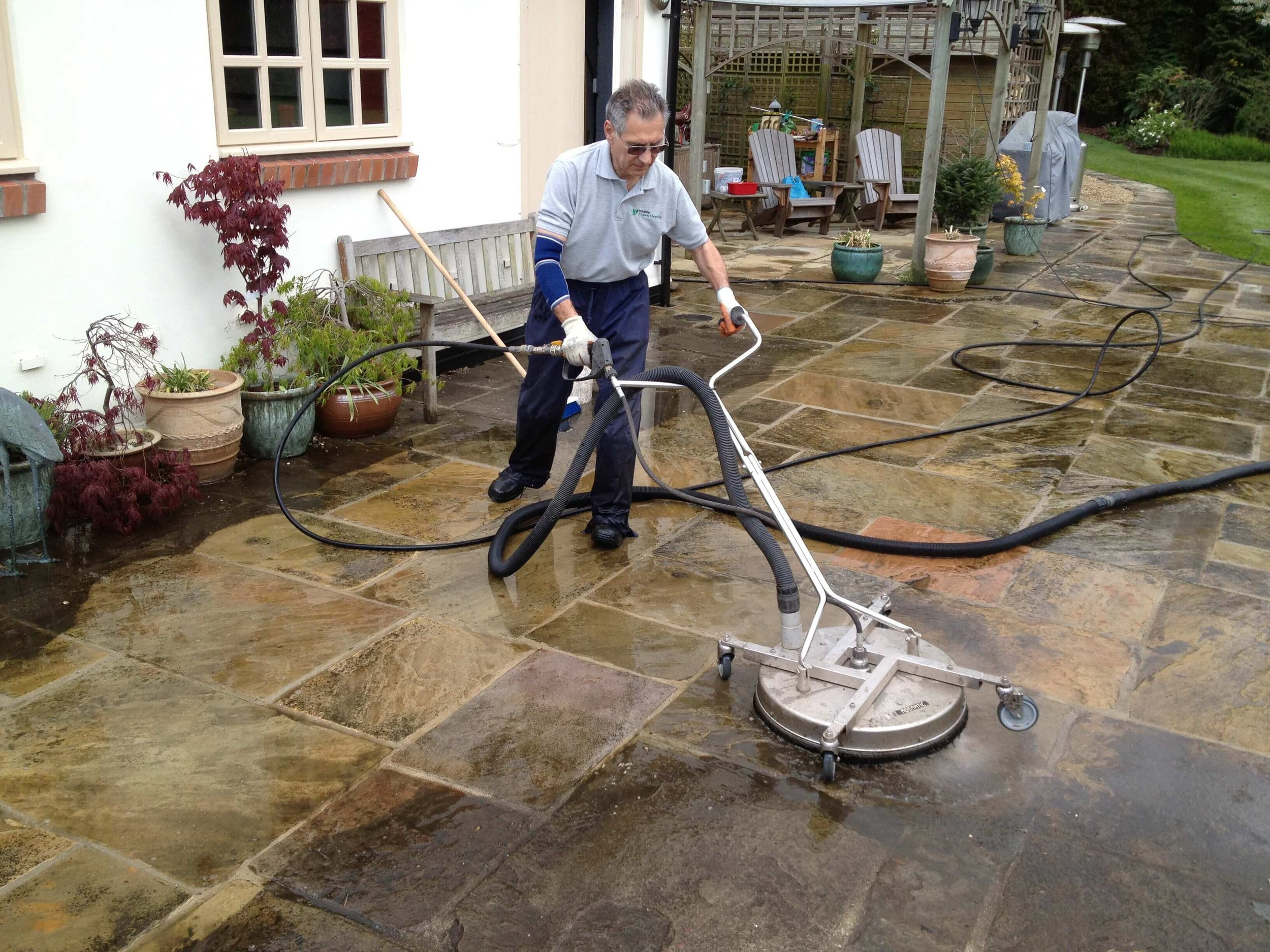 With state of the art pressure washing machines we can restore your patio and hard surfaces to pristine condition. This large Yorkstone patio area was cleaned near Pontefract LS25.