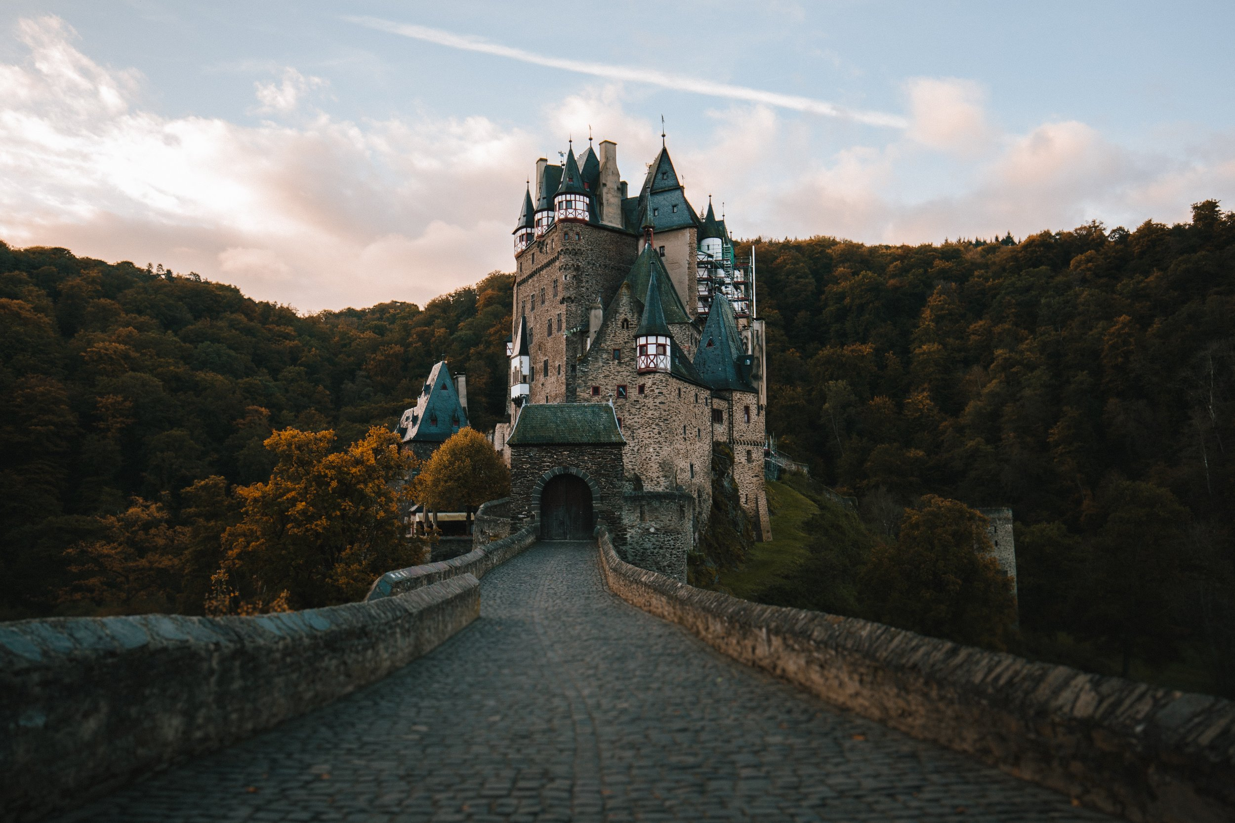 Fairy tale castle at the end of a cobbled street.