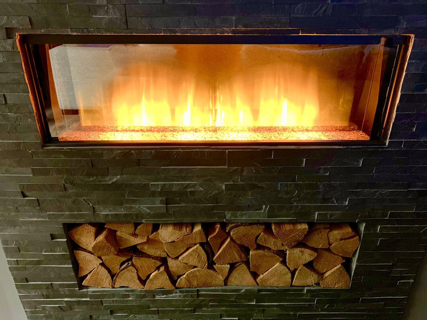 Our Departure Board - Newlands Lodges Review - Lit Fireplace