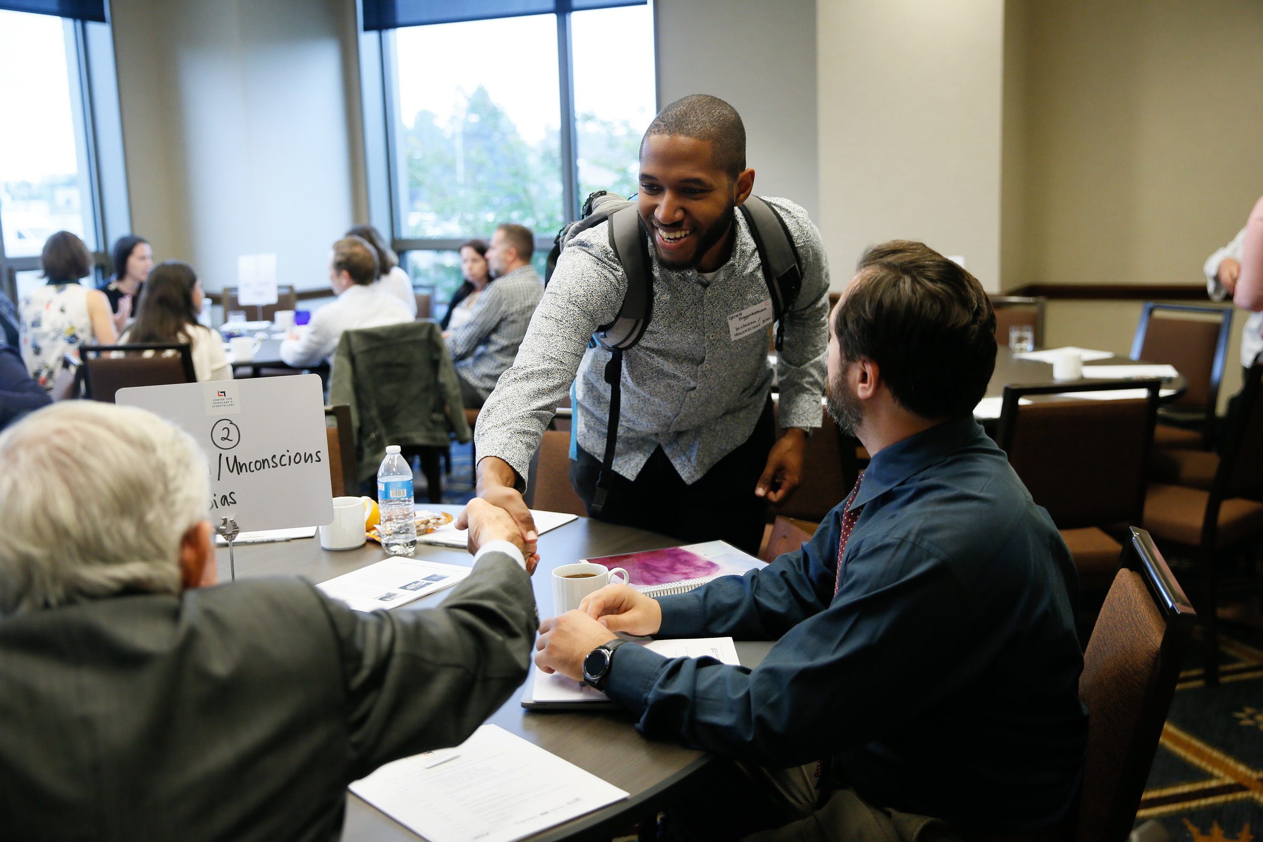 Morning introductions: Businessman and Diplomat Frank Baxter (left) Psychology graduate student Gerald Higginbotham, M.A. (center) and TFT student Matthew Johnson (right).