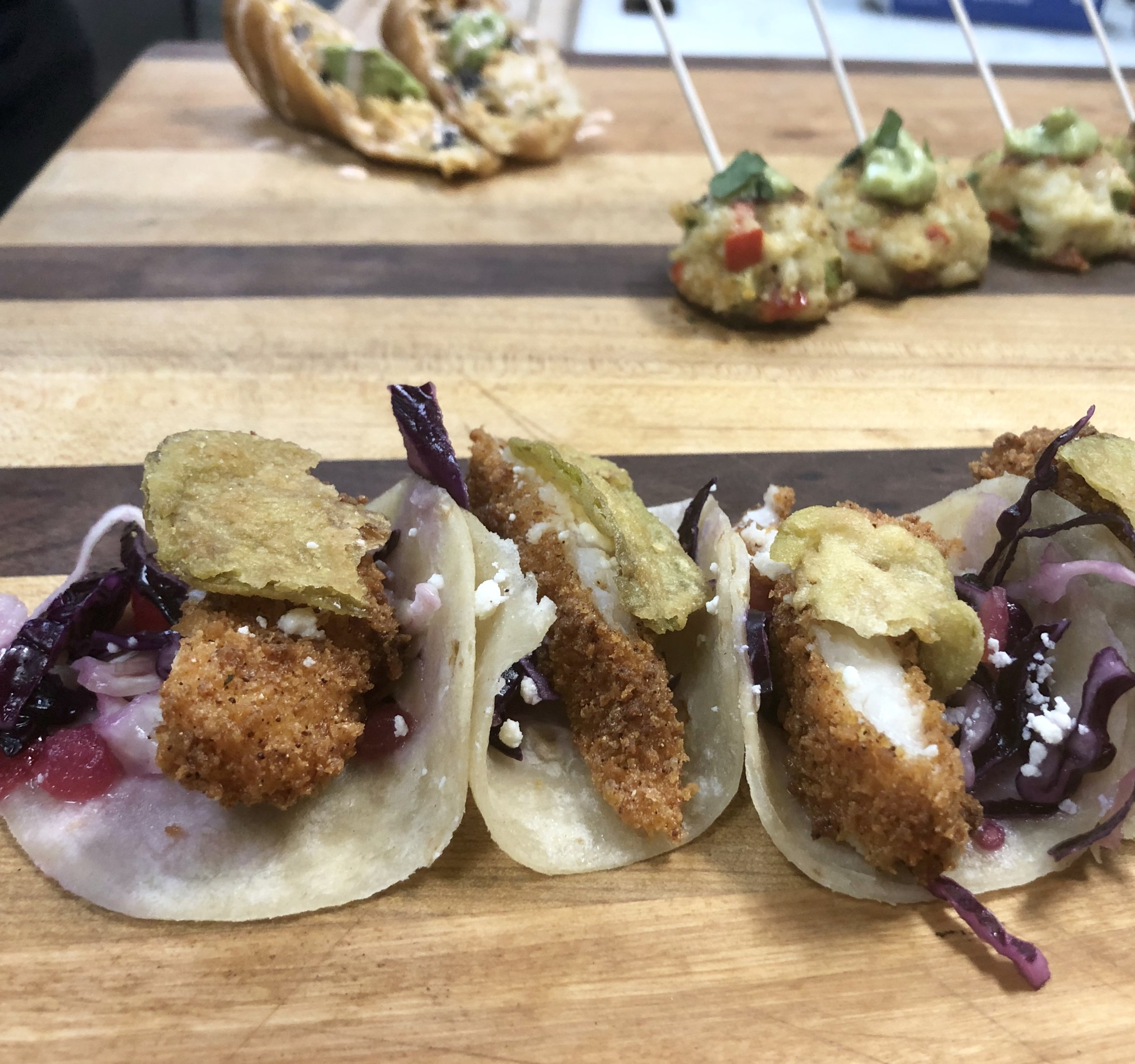 Mother's Catering Company takes a cue from sister company Mother's Cantina with these fried flounder tacos with Mexican slaw, queso fresco, and fried jalapeño on house made Mother's Flour Tortillas.