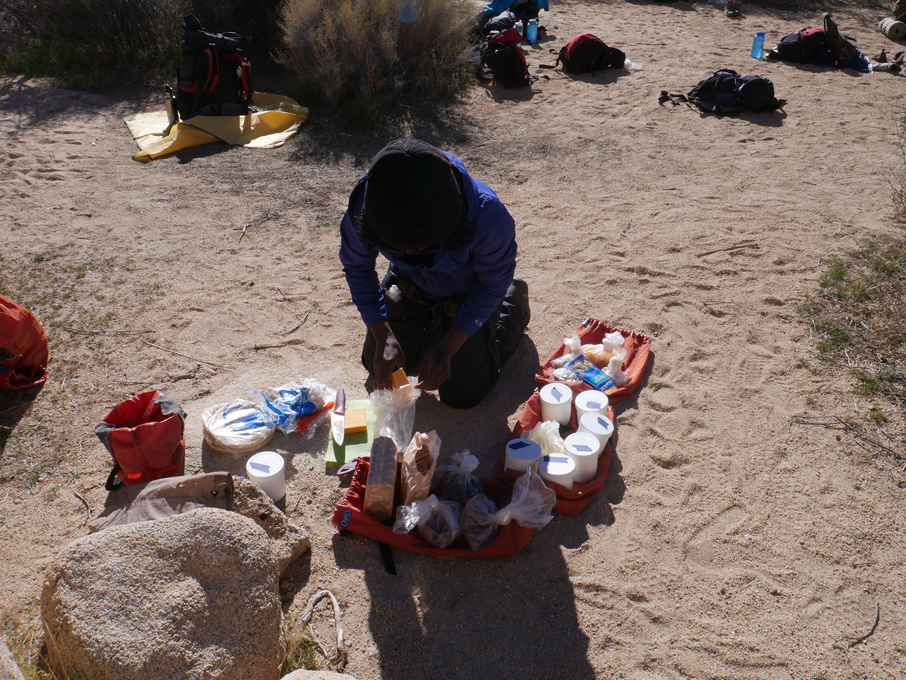 Felistus, assembling lunch for the rest of the backpacking group.