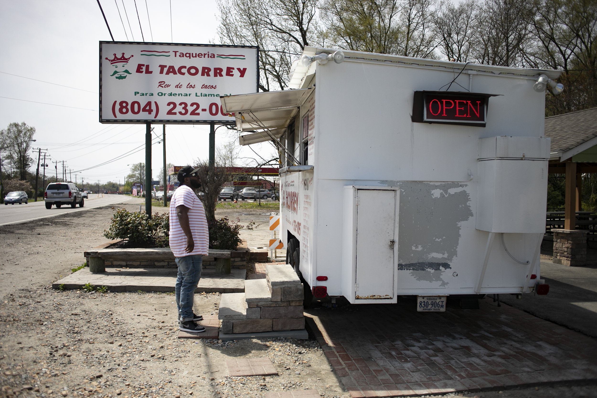 """Mike stands waiting for his tacos on April 8, 2019 in Richmond, Virginia. He call this area of Richmond """"The Multicultural Zone."""""""