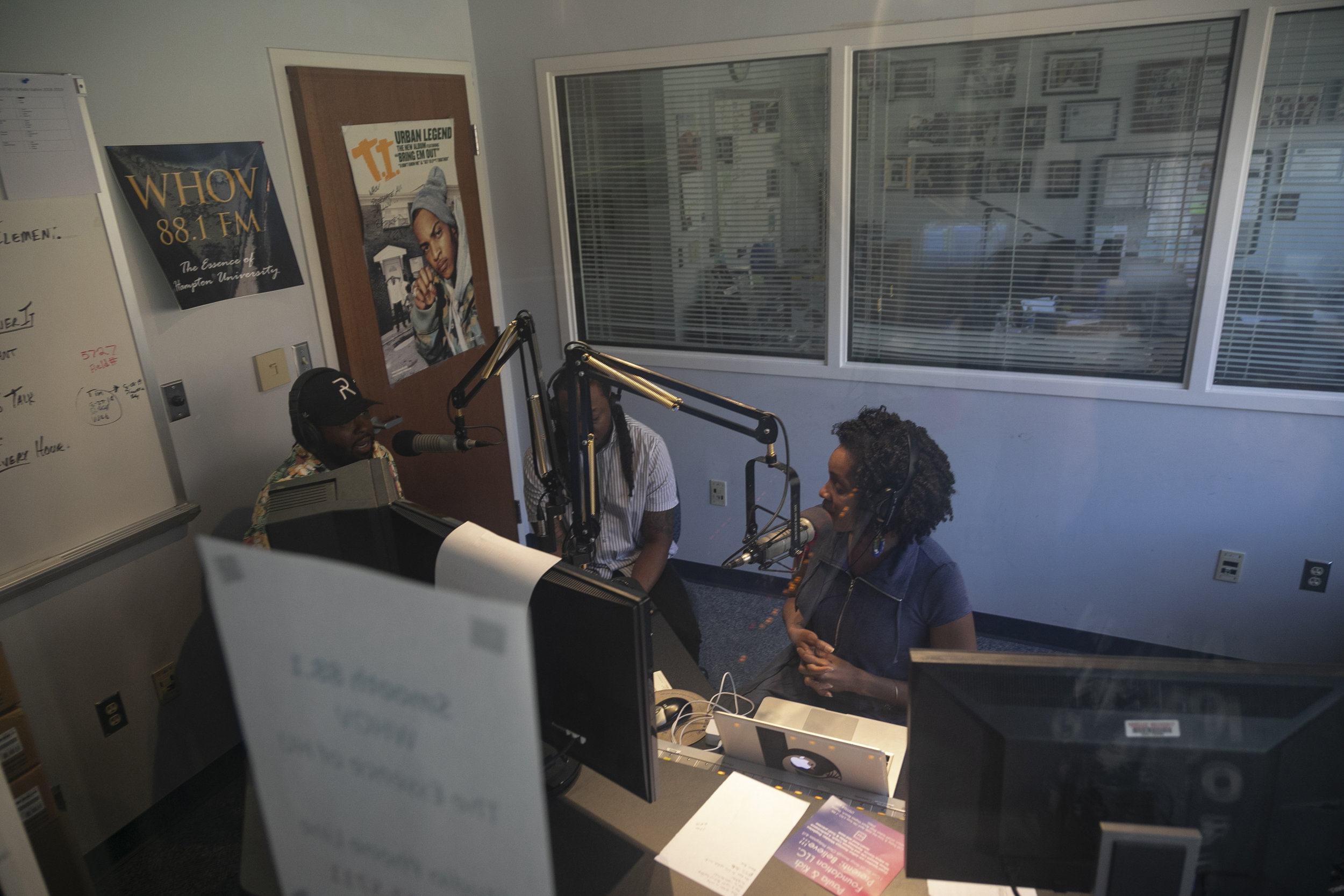 "Mike, his brother Brandon ""Namebrand"" Bass and radio host Blair Durham talk about the business of music  on a radio show April 17, 2019 in Hampton, Virginia."