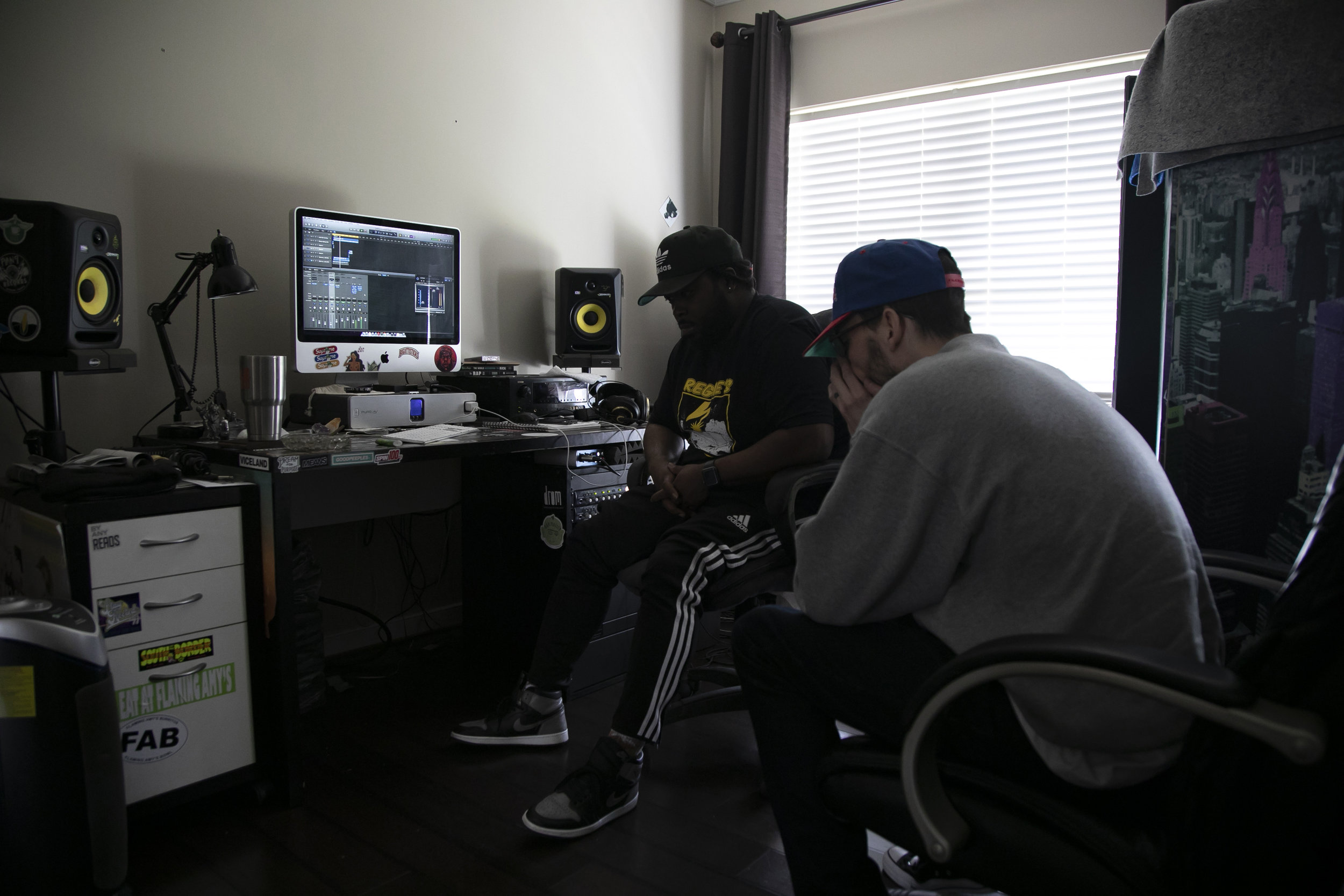 Mike and Richmond Producer Fan Ran listen for any production issues on the final cut of an unreleased album on March 30, 2019 in Richmond, Virginia. Most of Mike's time is spent mixing and mastering projects for both local and high profile artists, it's his breadwinner.
