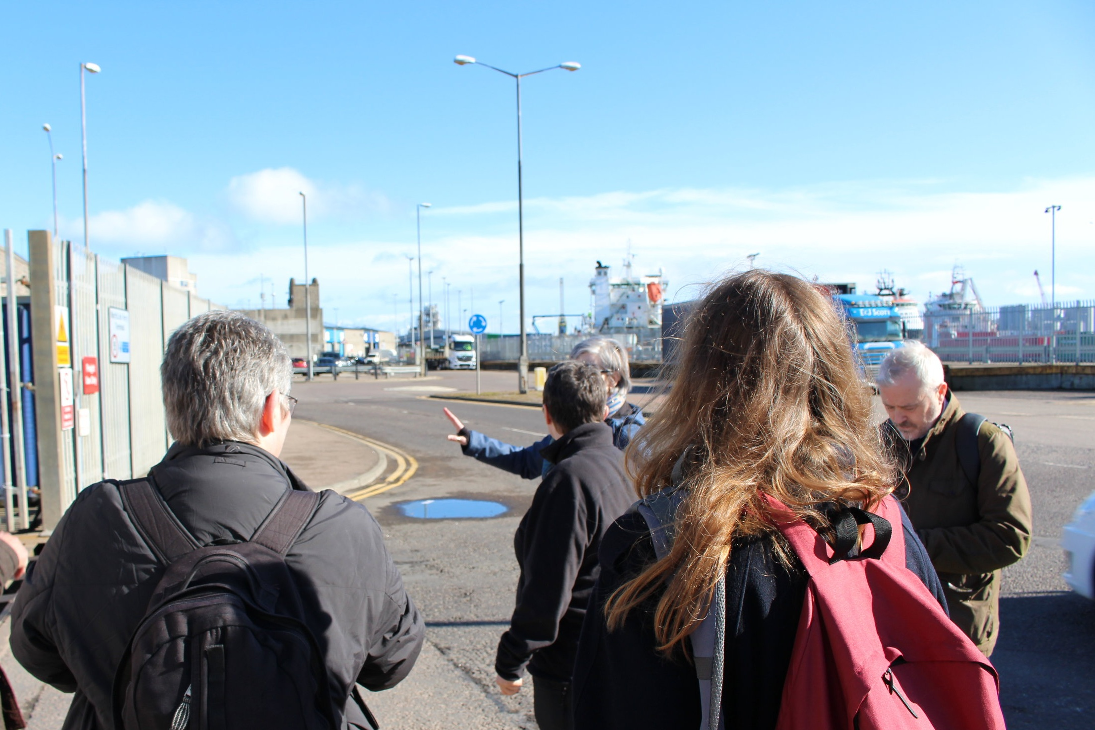 Description: The group considers a road crossing and surfaces on the way to the harbour.