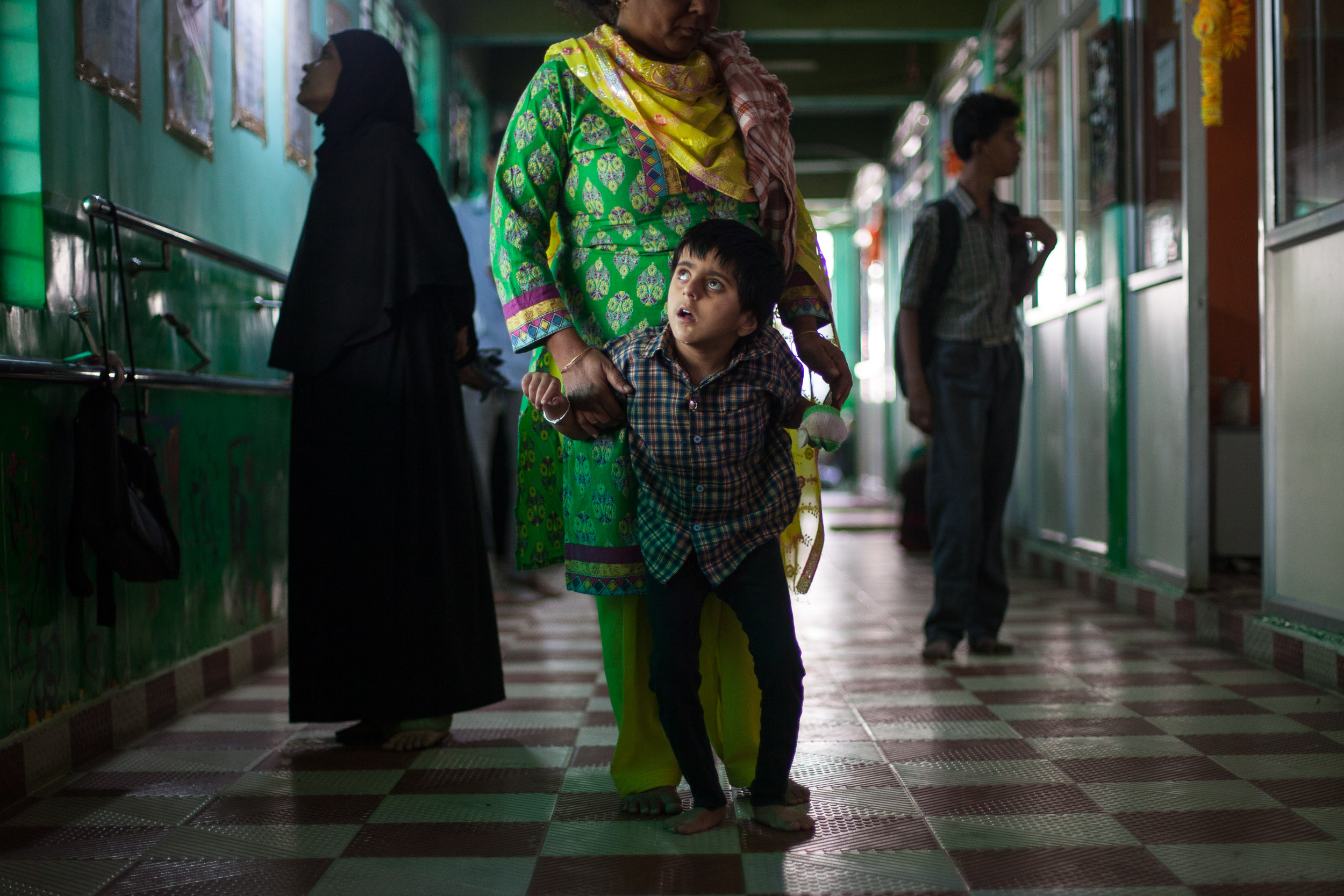 Prachi can only walk with help. She has never learned to talk, and must wear a glove on her left hand to avoid biting herself. She is one of the many children who continue to be born with mental and physical disabilities in Bhopal.