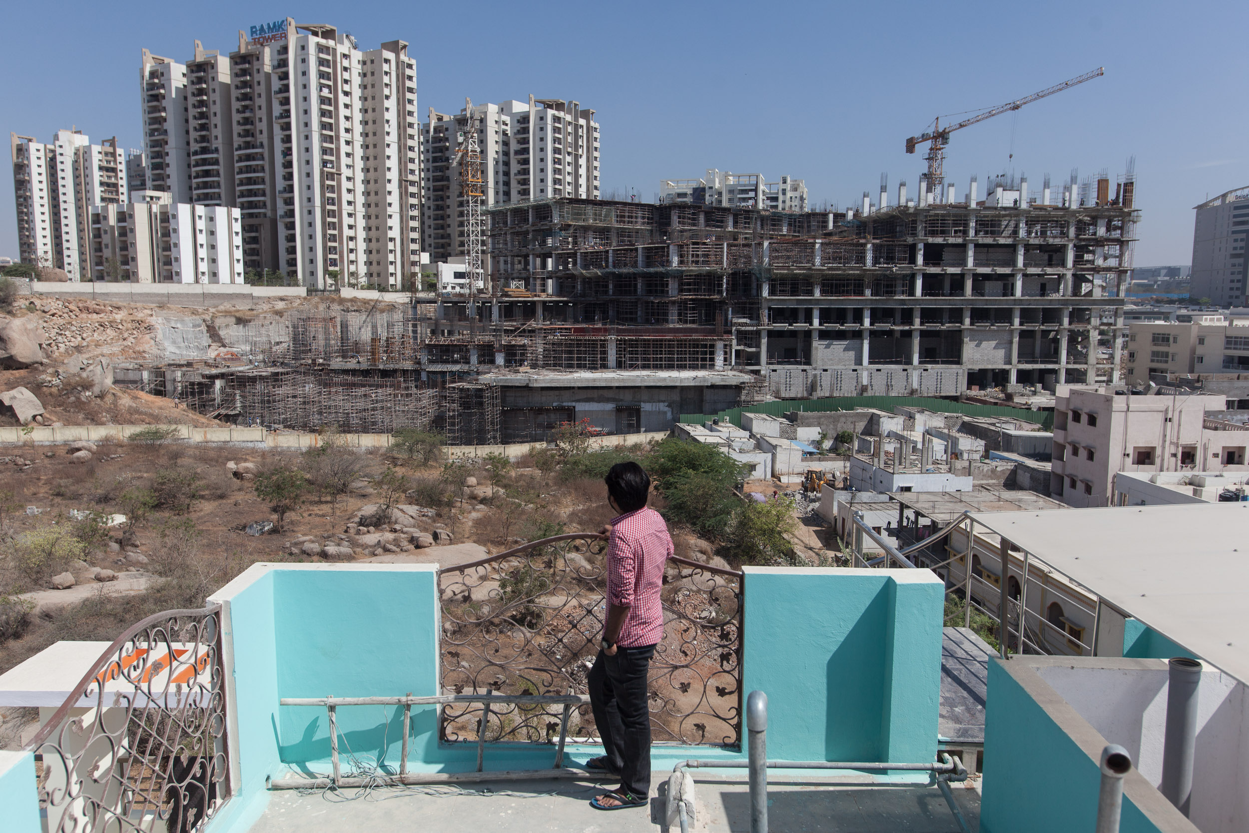 A 30 year-old management consultant, who has been denied an H1-B looks towards Cyberabad area from the terrace of his apartment.