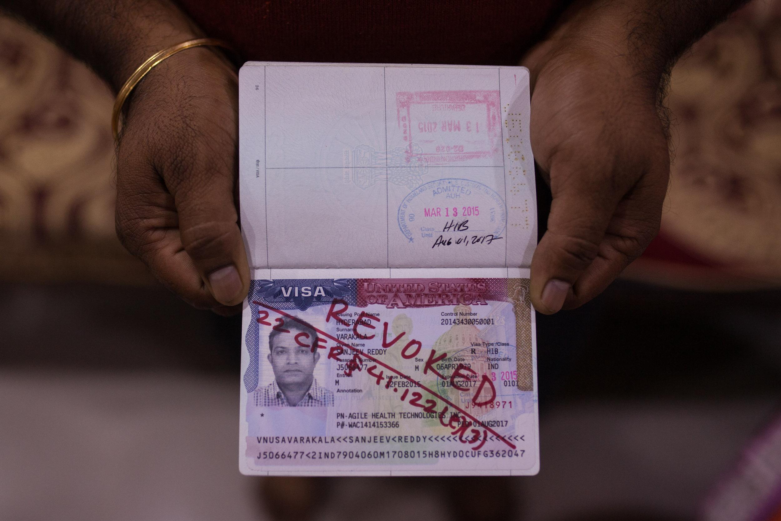 Sanjeev's Indian passport, with the revoked U.S. visa.