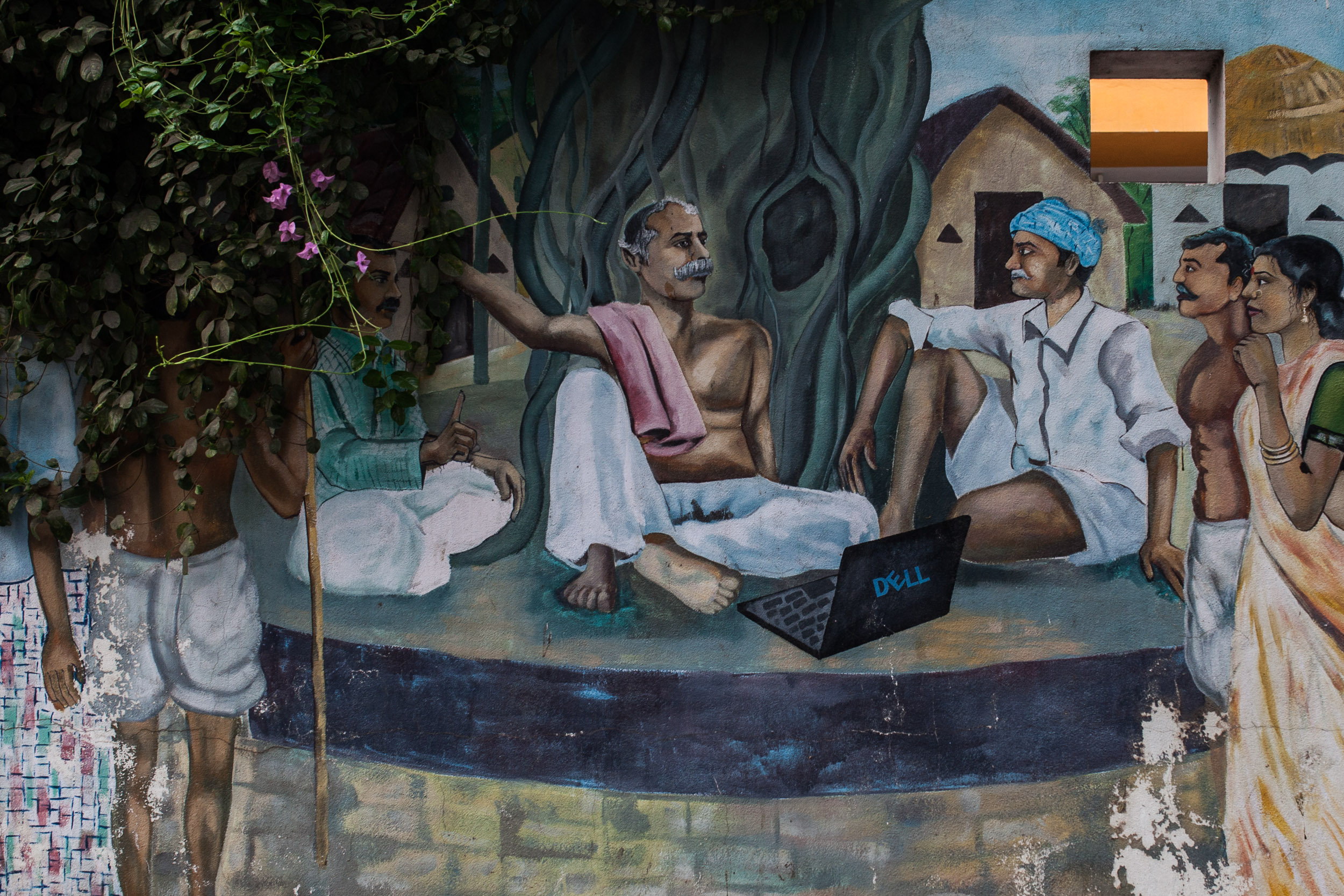 A mural in the technology hub of Hyderabad, India, depicts traditional villagers using modern tools such as a laptop.