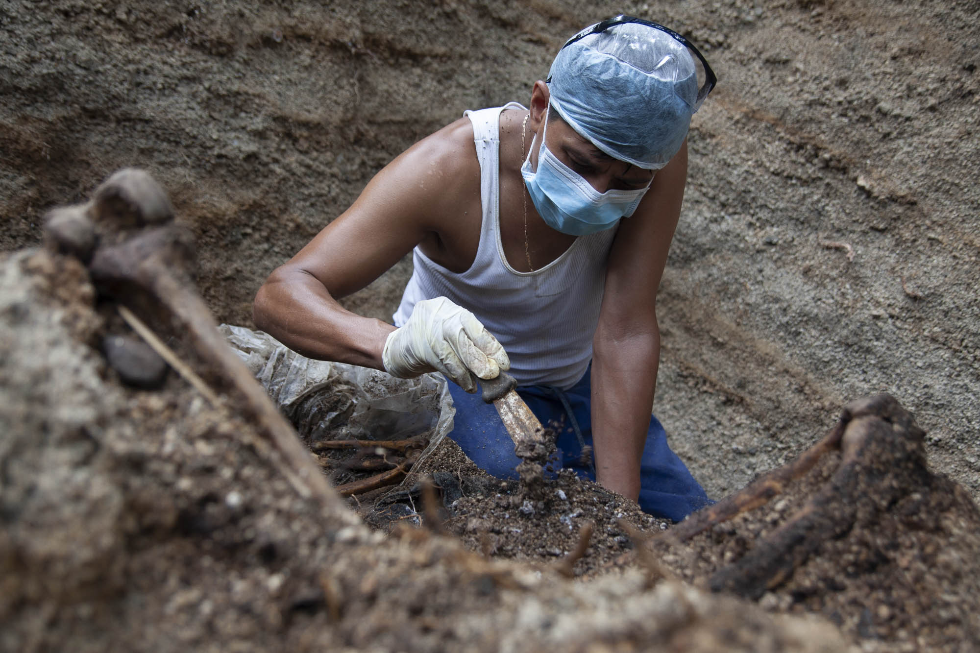 Israel finishing his work in one burial site use by the gangs to dispose killed people.