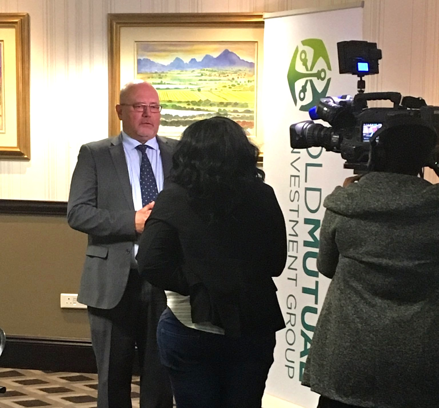 SABC 1 interviews an economist from Old Mutual Investment Group at their quarterly media briefings.