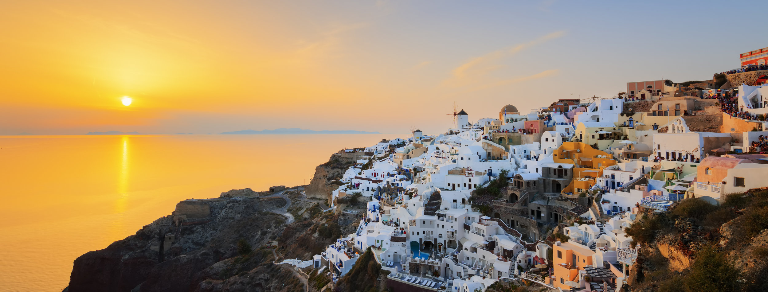 Panoramic-view-of-Oia-at-sunset-578310406_5760x2191.jpeg