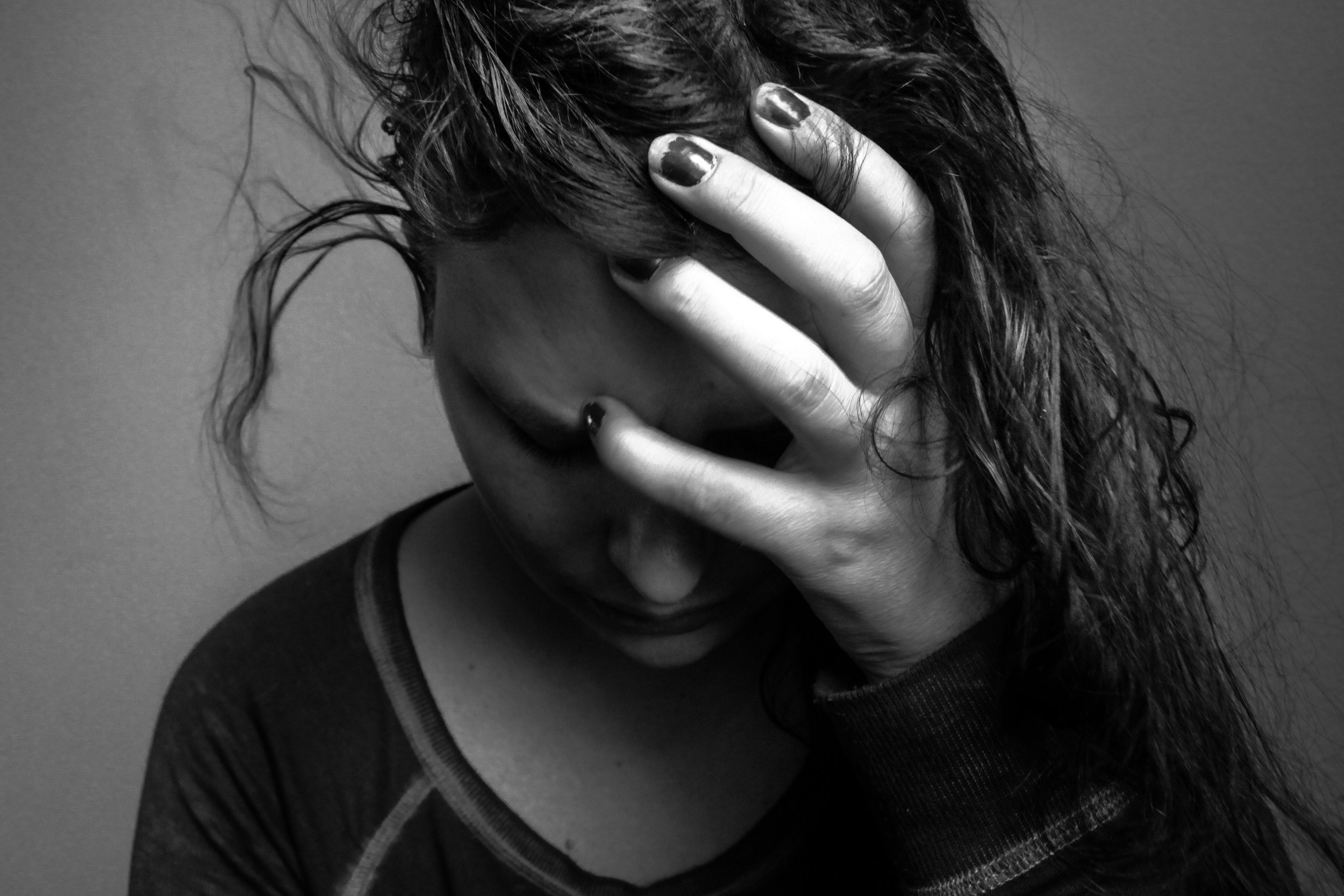 close-up-of-young-woman-sad-frustrated-somber-depressed-emotional-stress-520227582_5184x3456.jpeg