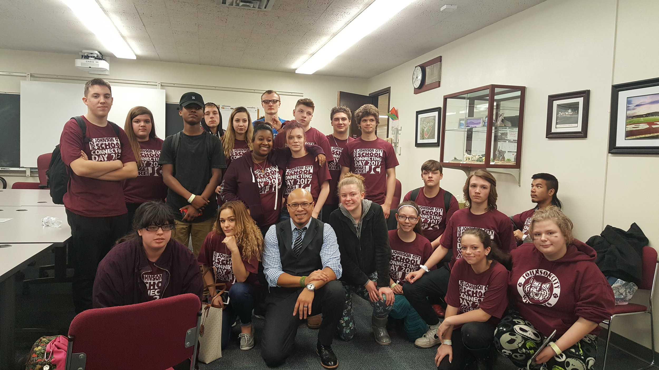 Emad with students at Johnson City High School