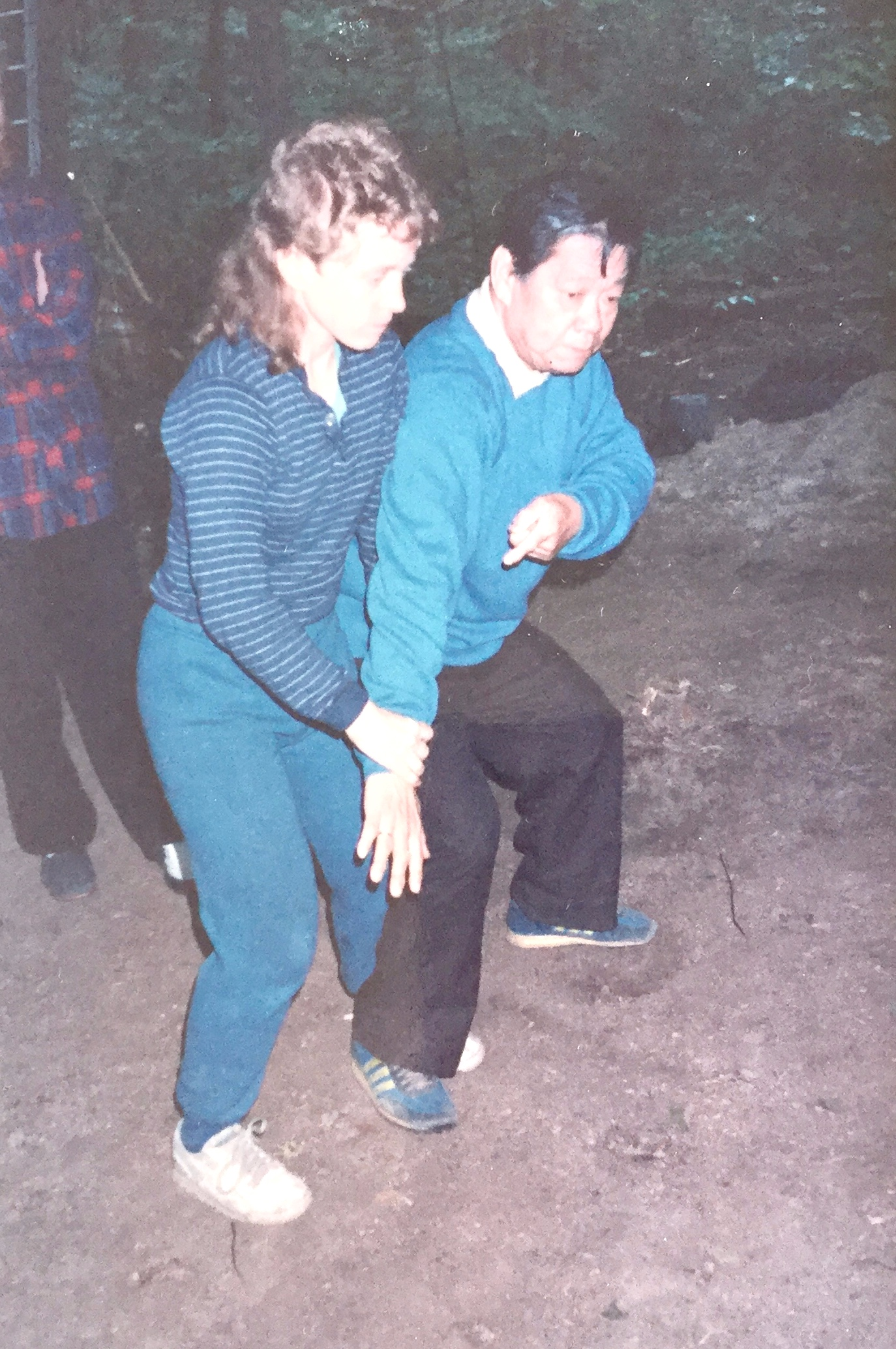 Mary Christianson and Master B.P. Chan demonstrate Bagua applications at the Tai Chi Farm in Warwick, NY, mid-1980's.