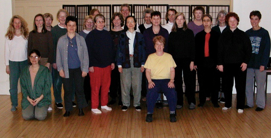 Mary Christianson (seated) with students of Women's Self-Defense class at Brookline Tai Chi, 2003.