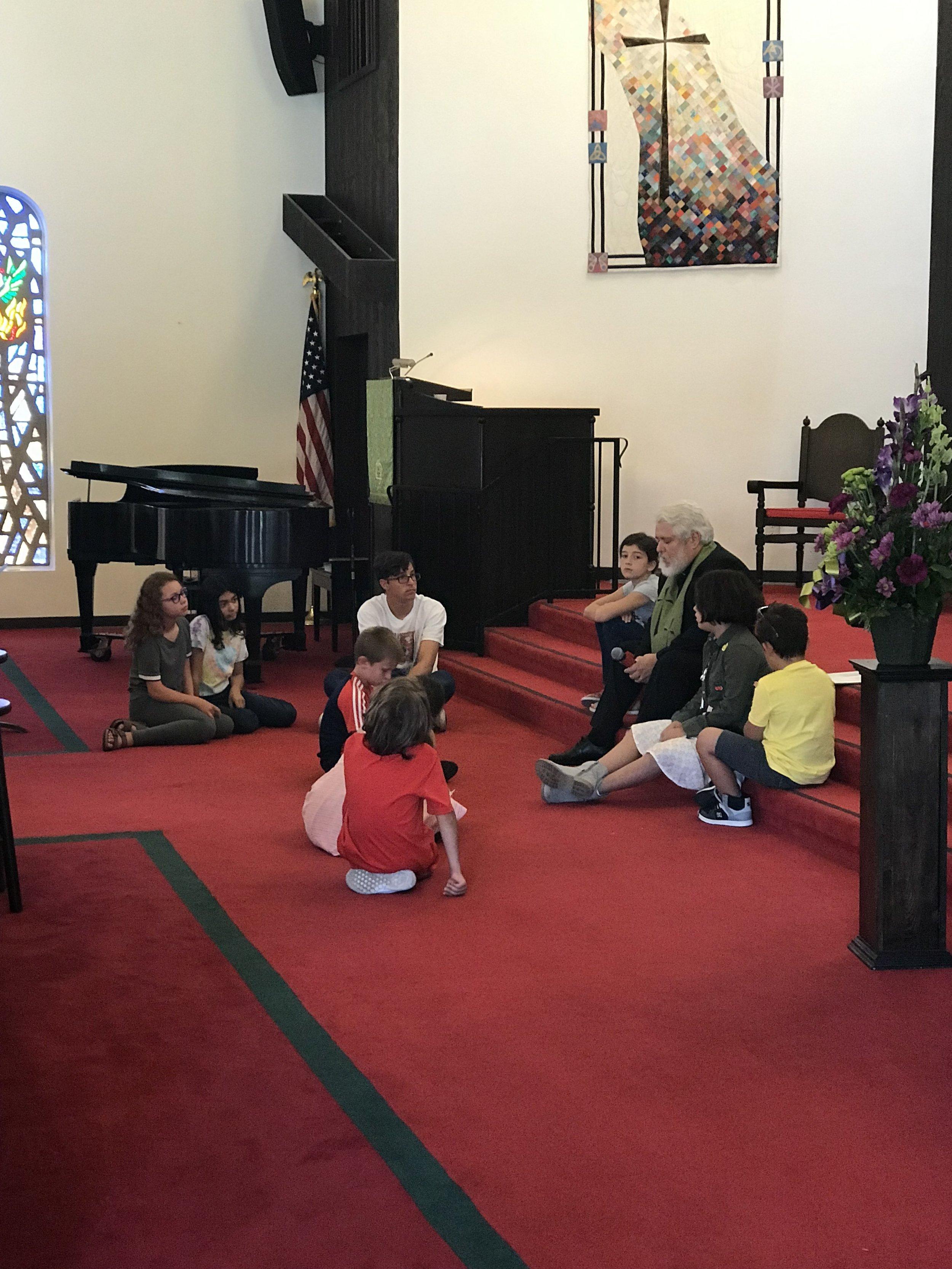 Kids in Sanctuary with John 2.jpg