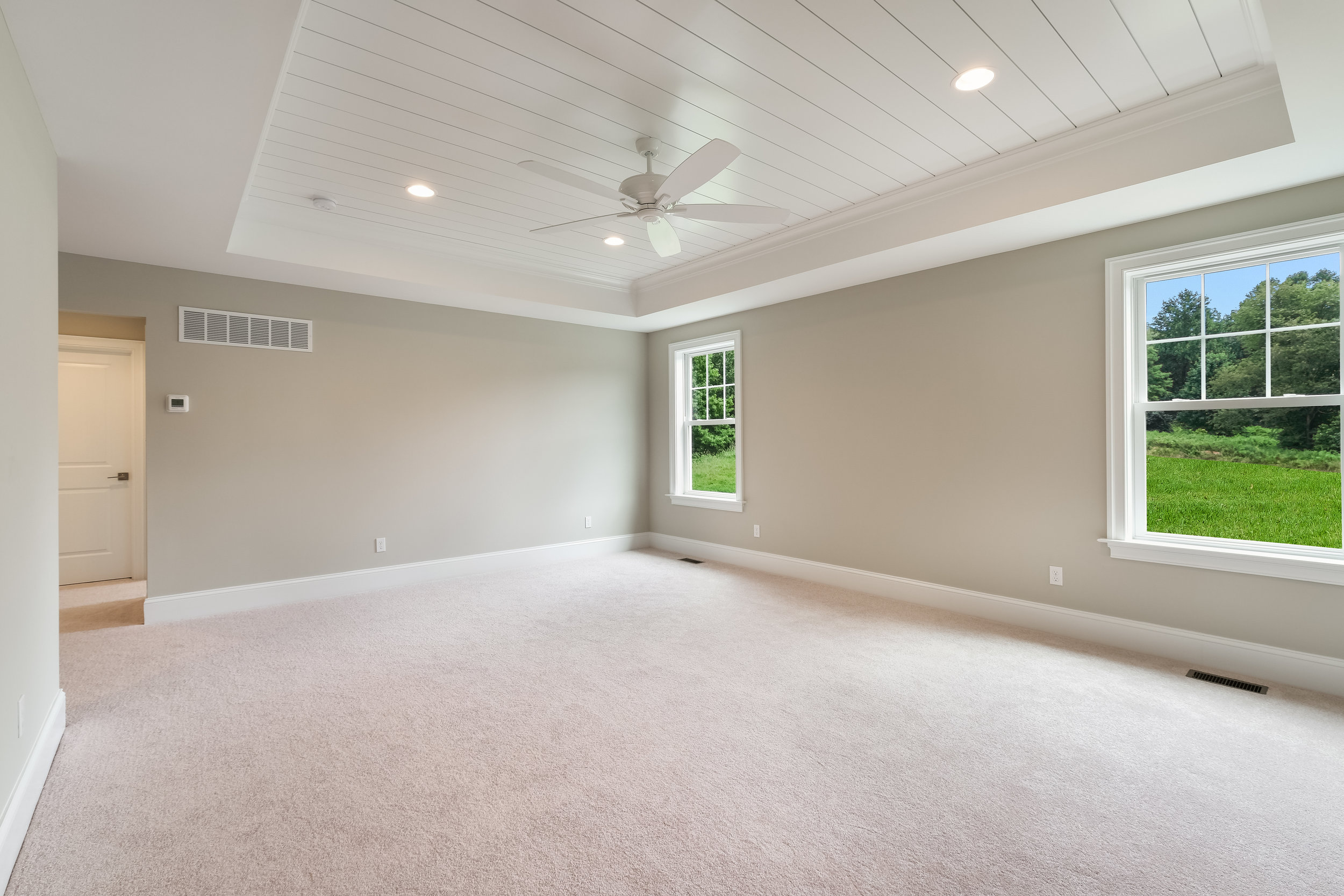 Breathtaking Master Retreat with Shiplap Tray Ceiling, En Suite 4-Piece Bath, and Extravagant Walk-In Closet