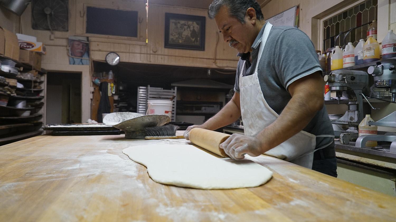 hmb_bakery_desi_rolling_dough.JPG