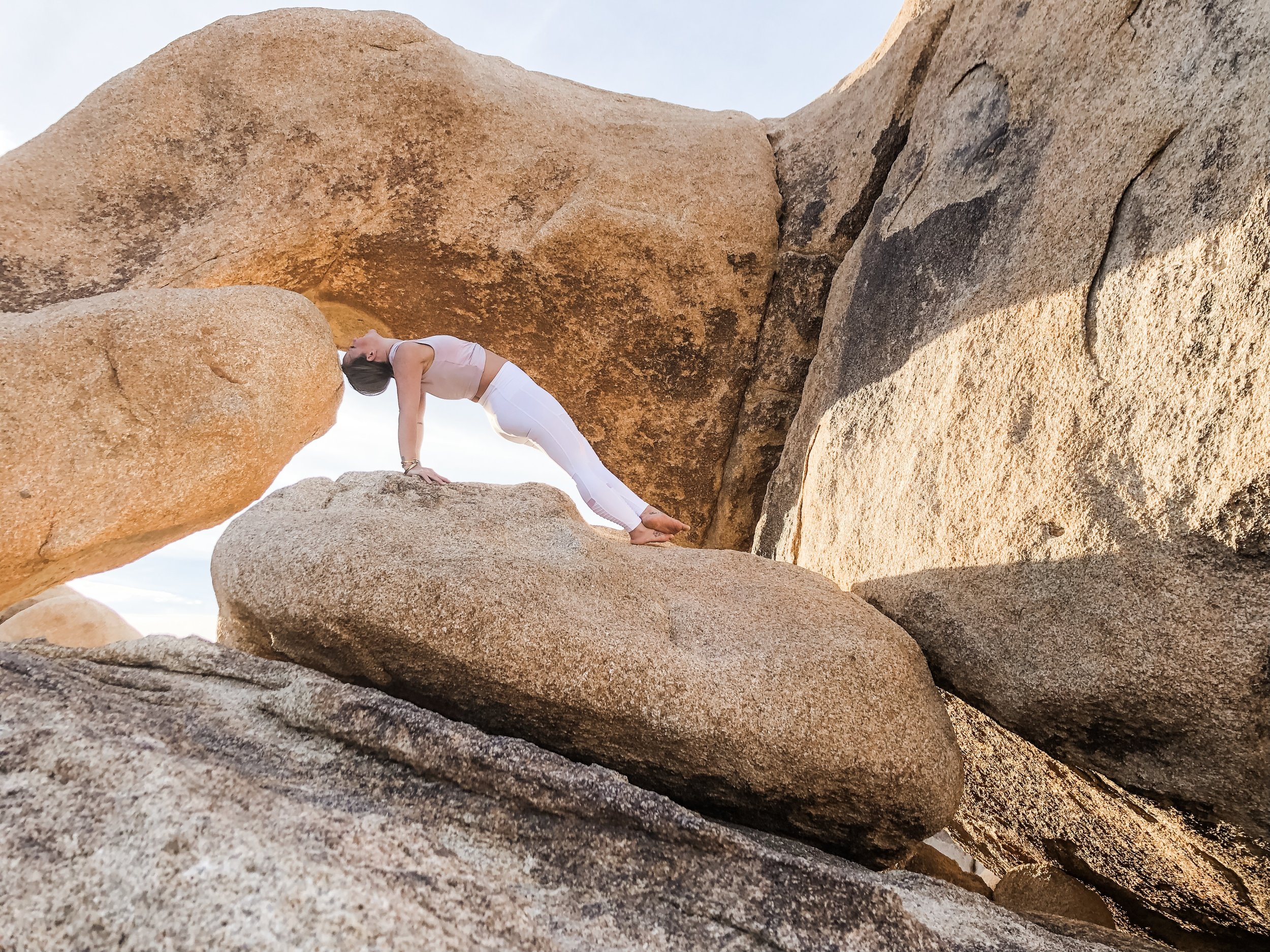 Arches at  Joshua Tree  National Park, CA ; Wearing  Alo Yoga