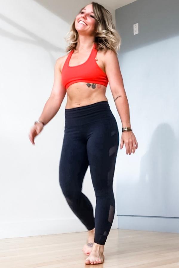 Wearing  Alo Yoga leggings  and  Beyond Yoga sports bra