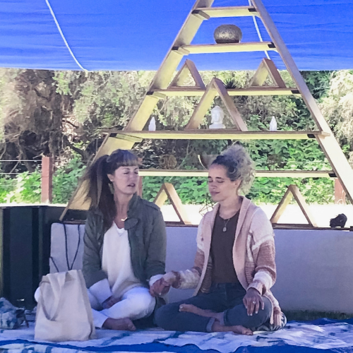 Erin Telford and her assistant setting the intention for our sacred space and deep work at Wanderlust 108 in San Francisco.