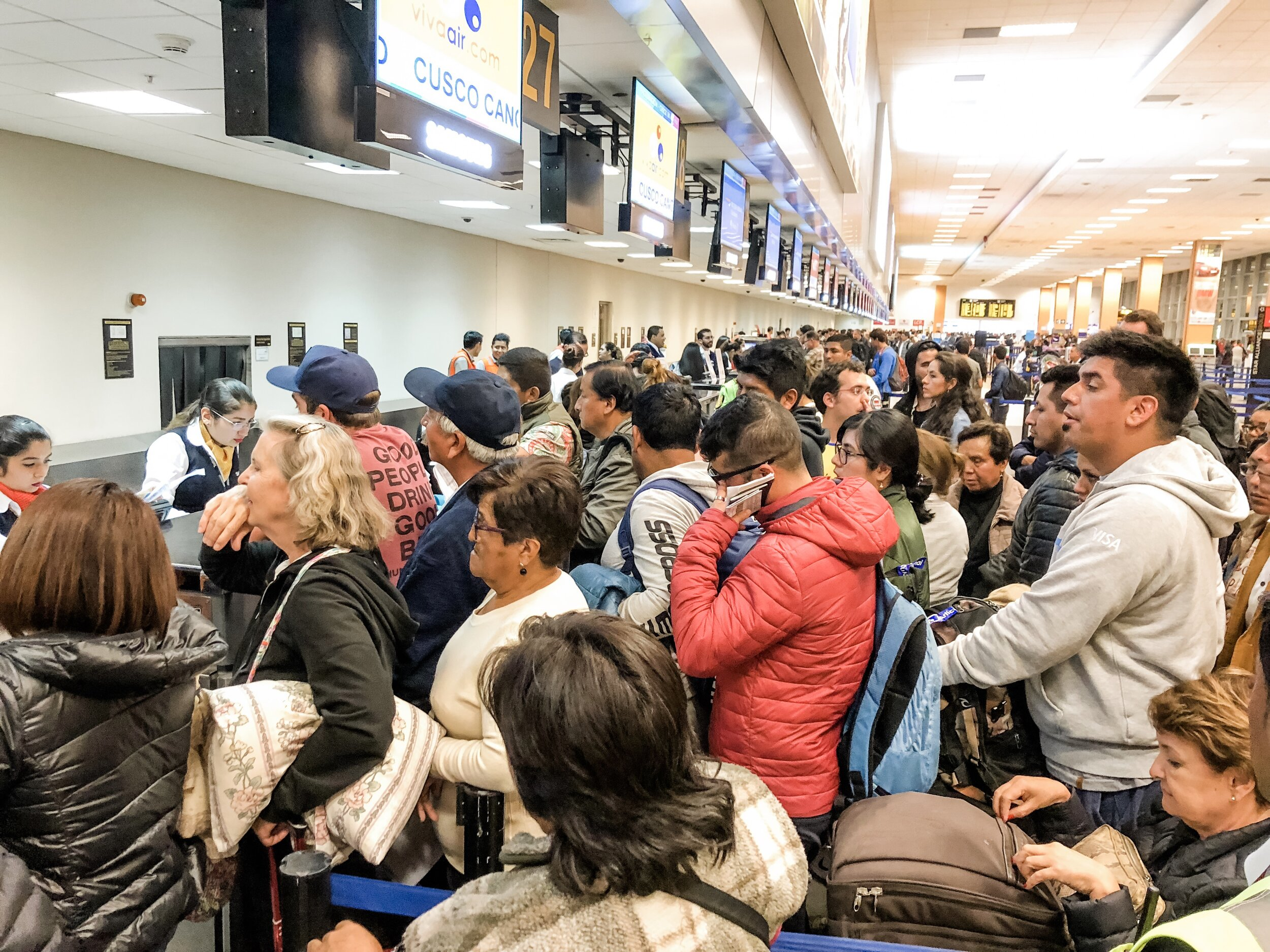 Lima Airport: Picture a bum rush of people to the front, people yelling in Spanish at the top of their lungs, and two workers left alone trying to help a plane full of stranded travelers.