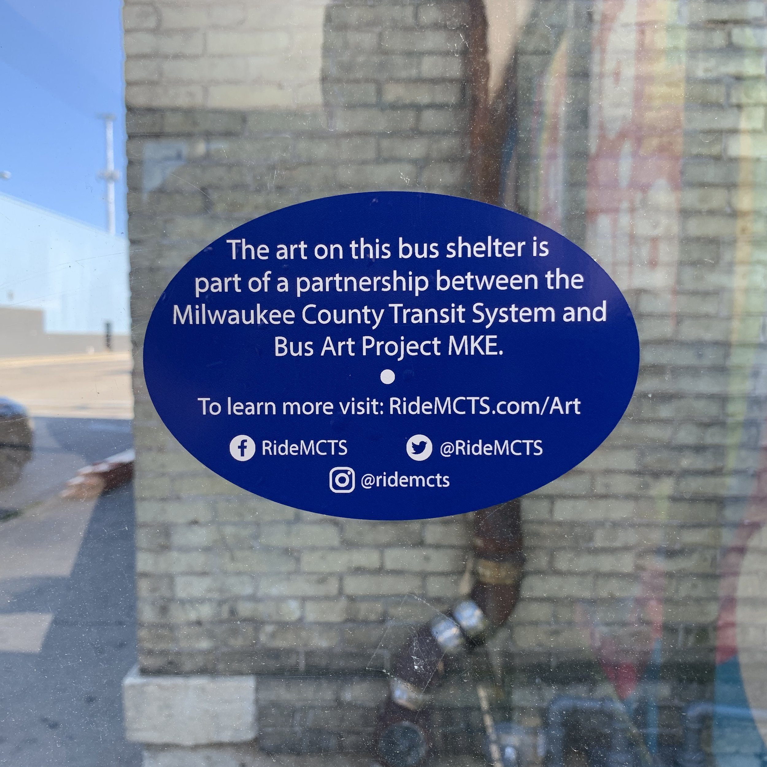 A sticker on the bus shelter giving context to the project.