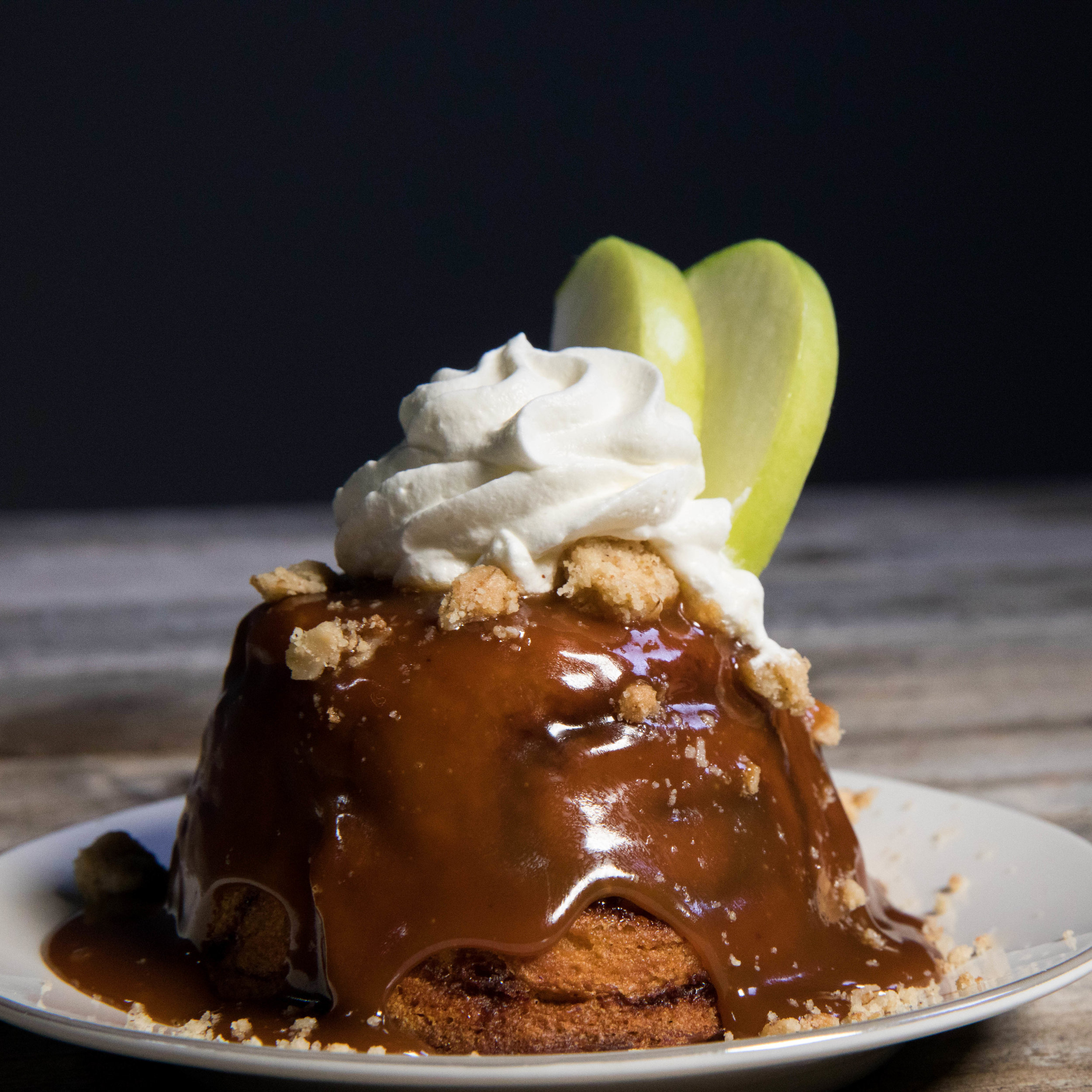 Upside Down Caramel Apple Pie |  our specialty pie crust filled with sautéed apples covered in a heated salted caramel sauce and streusel topping