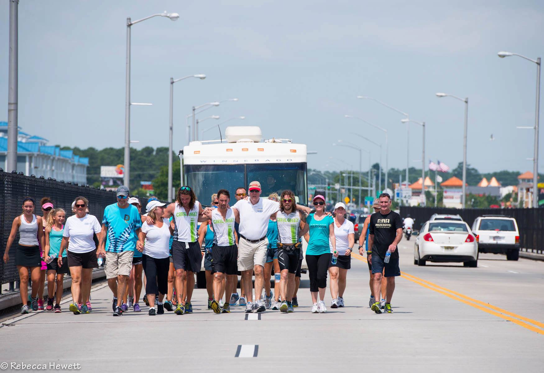 "Landon, his two running partners and several guests take the final steps to Ocean City, Maryland after 157 days running across the USA. Two ""Key To The City"" awards were awarded for successfully completing their mission, and their efforts inspired thousands around the world. July 20, 2013"