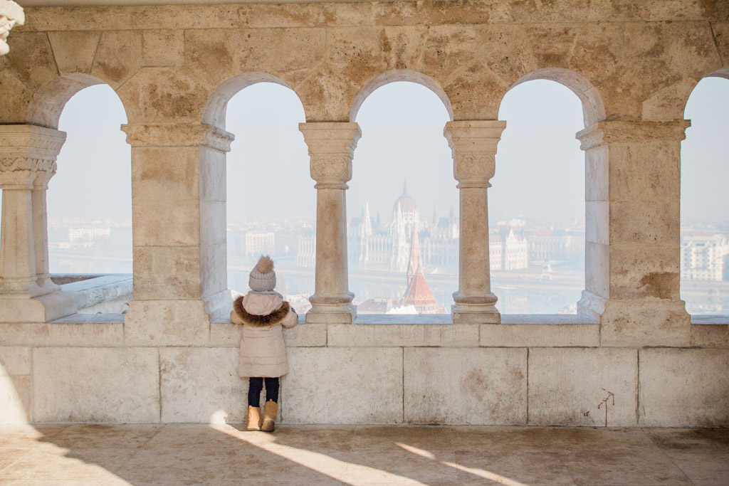My daughter looking at the Hungarian Parliament building from Fisherman's Bastion.