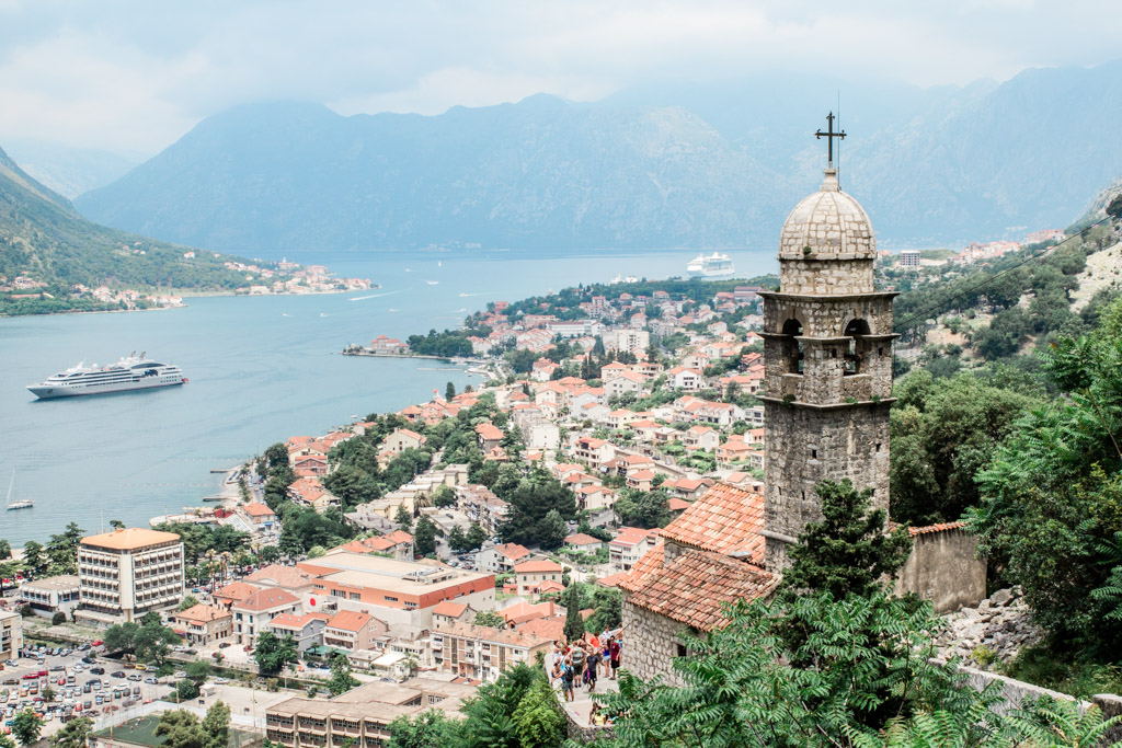 The view over the Bay of Kotor and a stone church from the city walls in Kotor, Montenegro.