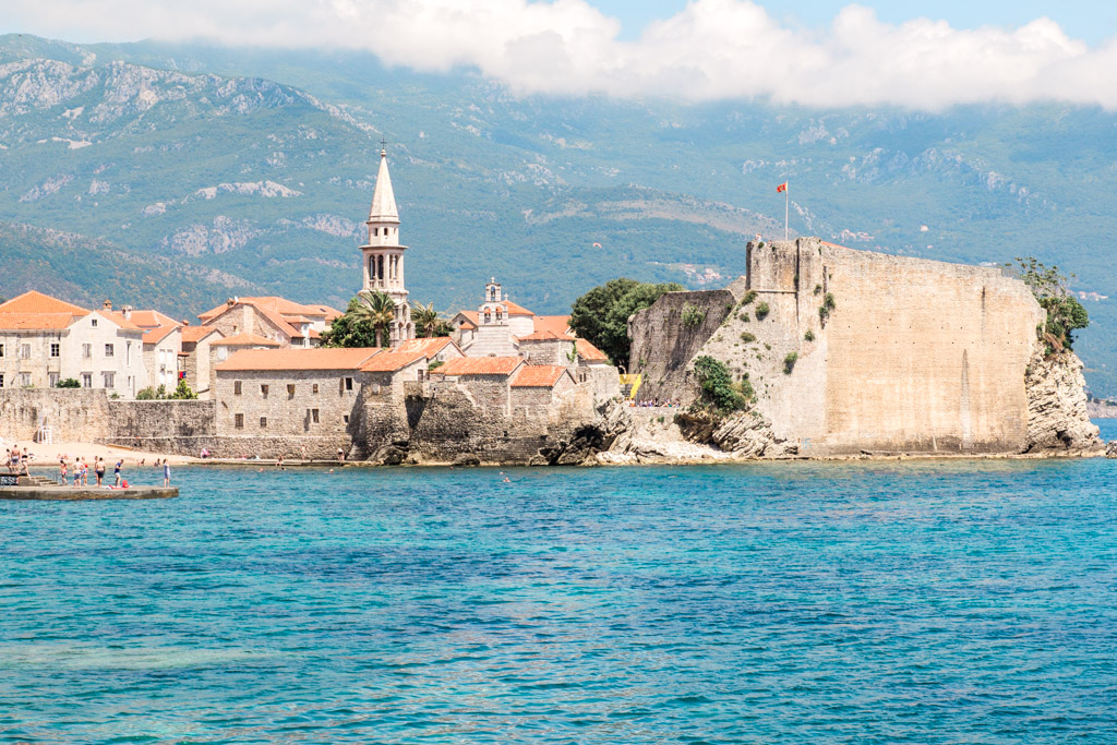 Blue water and walled Old Town Budva, Montenegro.