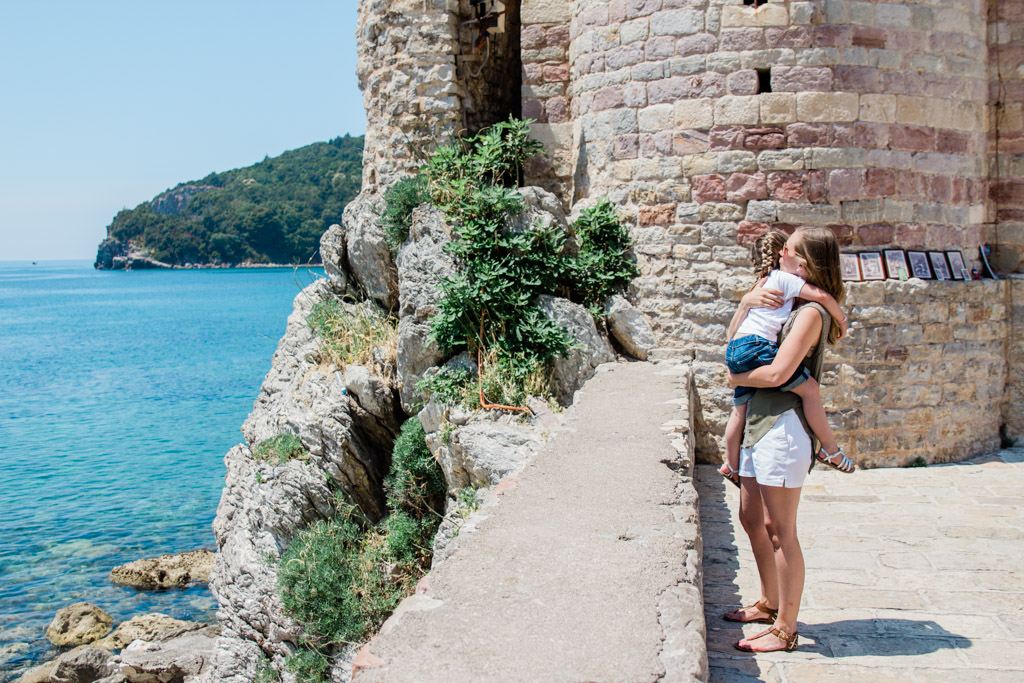 Giving my daughter an oceanside hug in Budva, Montenegro.